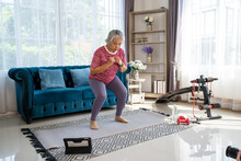 Senior Woman Workout For Her Knees With Squat At Home