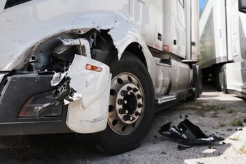 Damage closeup on white truck.