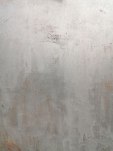 Texture Of Old Painted Rusty Grey Wall Or Garage Door With Peeling And Cracked Paint And Corrosion