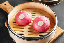 Closed Bao Bun With Sweet Berry Inside. Delicious Chinese Steamed Sweet Food. Chinese, Asian, Authentic Food Concept