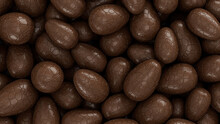 Chocolate Easter Egg Background. Easter Wallpaper Showing A Collection Of Chocolate Eggs. 3D Render