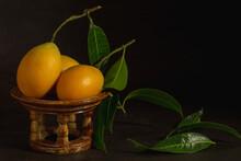 Marian Plum Fruits On Little Kantoke Isolated On Dark Background.