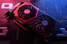 Computer Game Graphics Card, Videocard With Two Coolers On Circuit Board ,motherboard Background. Close-up. With Red-blue Lighting