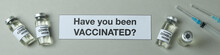 Text Have You Been Vaccinated, Syringes And Vials Of Covid - 19 Vaccine On Gray Background