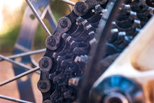Mountain Bike Used And Dirty Gear Cassette Cogs Macro Close Up Shot Outside