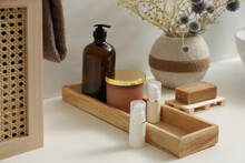 Personal Hygiene Products And Toiletries On Table In Bathroom