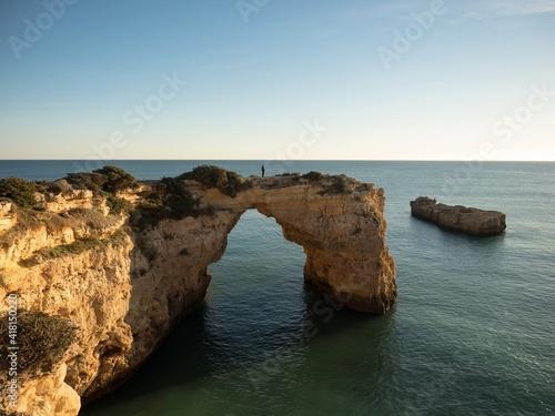 Canvastavla Panorama view of natural limestone arch bridge Arco de Albandeira beach atlantic