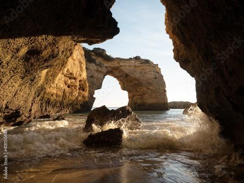 Fotografiet Panorama view of natural limestone arch bridge Arco de Albandeira beach atlantic