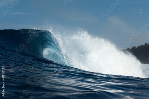 Clean and powerful wave breaking on a beach of Indonesia
