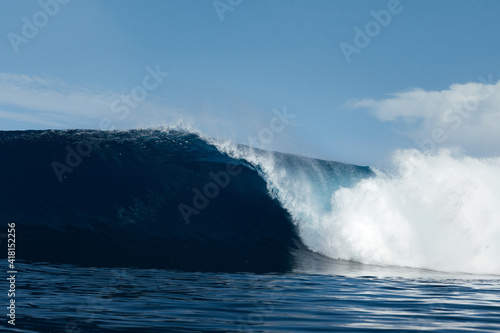 Blue and powerful wave breaking on a beach in Atlantic Ocean