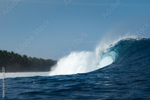 Blue and powerful wave breaking on a beach of Indonesia