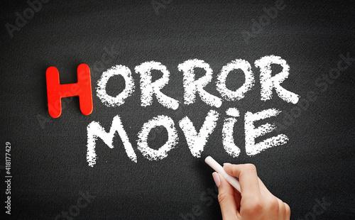 Fototapeta Horror movie text on blackboard, concept background