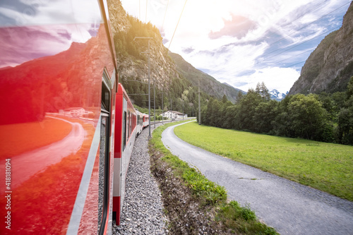 Fotografía Panoramic view of alpine mountains from swiss train