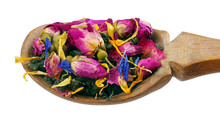 Green Blended Tea. Green Tea Leaves With Dried Rose Flowers In A Wooden Spoon Isolated On White.