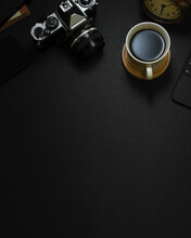 Creative Mock Up Scene, Black Table With Camera, Coffee Cup And Copy Space