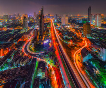 Bangkok Cityscape. View Of Trident Road At Sathorn, Taksin Bridge In Bangkok In Thailand At Night.