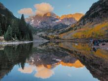 USA, Colorado, Maroon Bells. Mountain Lake Reflections In Autumn Sunrise.