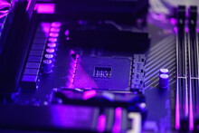 Blurred Background. Socket Am4. Close Up Of The AM4 Socket For The Motherboard With Neon Blue Light. Technological Background