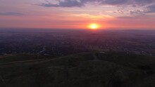 Wide Orbiting Aerial View Of The Malvern Hills At Sunrise.