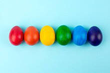 Multicolored Eggs At Studio On Blue Background