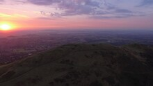 Slow Wide Aerial Orbit Of The Malvern Hills At Sunrise.