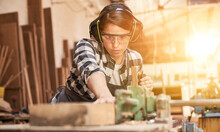 Woman Is Training To Be A Carpenter In Workshop