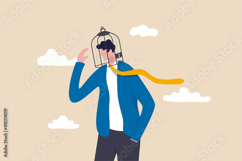 Limited understanding, creativity blocker, fear of challenge, bias or ego trapped, powerless or lack of intelligence concept, depressed businessman with birdcage lock his head Fototapet