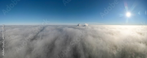Obraz na plátne elektrownia Rybnik, kominy nad mgłą z lotu ptaka