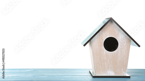 Valokuva Beautiful bird house on light blue wooden table against white background, space