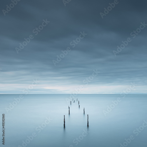 Fotografie, Tablou Wooden docks in the sea merging with the sky
