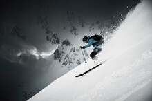 Male Skier Speeding Down Steep Mountainside, Alpe-d'Huez, Rhone-Alpes, France
