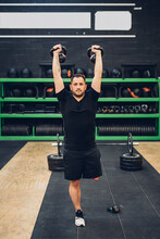 Man With Disability Using Kettlebells In Gym