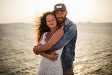 Romantic Couple Hugging On Coast, Portrait, Santa Teresa Gallura, Sardinia, Italy