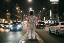 Astronaut In Middle Of Busy Street At Night