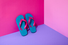 Pair Of Colourful Flip-flops Leaning On Wall