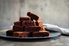 Chocolate Brownies On Plate With Napkin
