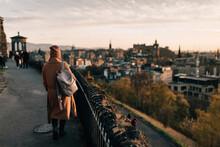 Woman Enjoying View From Calton Hill, Edinburgh, Scotland