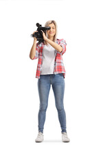 Full Length Portrait Of A Young Casual Woman Recording With A Camera