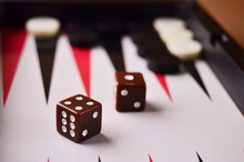The Dice Are Brown Close-up On The Backgammon Board. Play A Board Game. High Quality Photo
