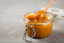 Close-up Of Jar Full Of Dulce De Leche. Dulce De Leche, Traditional Sweet In Latin America.