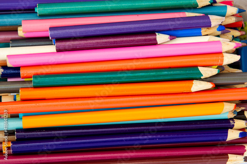Fotografiet Collection of brightly colored pencil crayons; Used colored pencils tossed in a