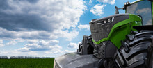 Green Tractor On A Agricultural Field
