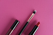 Set Of Makeup Cosmetics On Pink Background.