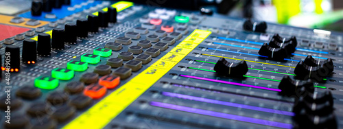 Fototapeta Sliders and buttons on Audio Mixing Desk at live event. obraz
