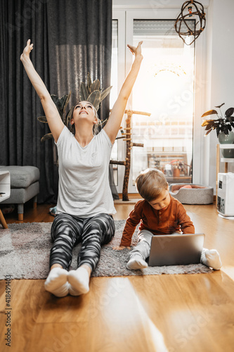 Canvas Beautiful young mother practicing fitness exercising and yoga together with her adorable little son