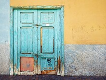 A Very Old Coffered Wooden Door Painted With Turquoise Paint