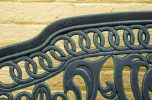 Beautiful Green Patina On A Wrought Iron Colonial Era Bench In The Historic District