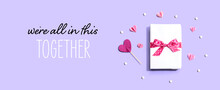 We Are All In This Together Message With A Gift Box And Paper Hearts