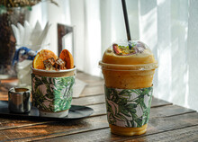 Dessert For Summer Time, Ice-cream And Passion Fruit Smoothy Time On The Wood Desk