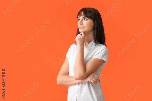 Obraz Beautiful thoughtful woman on color background - fototapety do salonu
